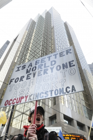 chanting: TORONTO - NOVEMBER 24: An occupy protester chanting slogans in front of the Toronto Stock Exchange during a rally on November 24, 2011 in Toronto, Canada.