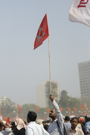 political rally: KOLKATA- FEBRUARY 13: A man waiving a communist emblem ed flag to somebody in the crowd, during a political rally in Kolkata, India on February 13, 2011. Editorial