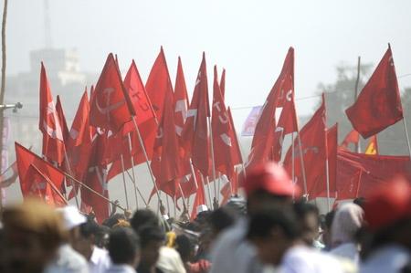 agitation: KOLKATA- FEBRUARY 13: Cluster of communist flags during a political rally in Kolkata, India on February 13, 2011.