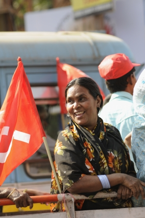 political rally: KOLKATA- FEBRUARY 13: A female supporter shares a smile on her way to the rally ground, during a political rally in Kolkata, India on February 13, 2011.