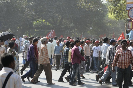 political rally: KOLKATA- FEBRUARY 13: Supporters in numbers crossing an intersection to get inside the rally premises ,during a political rally in Kolkata, India on February 13, 2011.