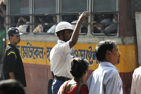 KOLKATA- FEBRUARY 13: A n active traffic constable during a political rally in Kolkata, India on February 13, 2011.