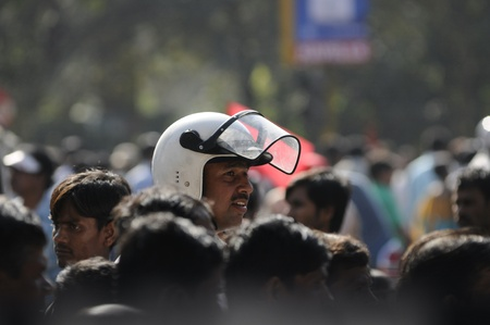 KOLKATA- FEBRUARY 13: A senior traffic constable looks at the approaching crowds, during a political rally in Kolkata, India on February 13, 2011. Stock Photo - 21209021