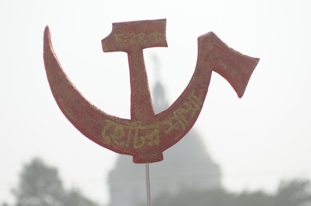 hammer and sickle: KOLKATA- FEBRUARY 13: The sign of \\\\\\\hammer & sickle\\\\\\\, against the most prestigious monument in Kolkata -The Victoria Memorial, during a political rally in Kolkata, India on February 13, 2011.