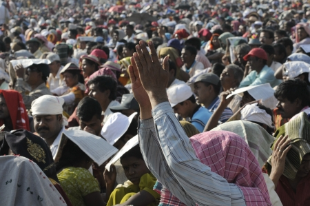 KOLKATA- FEBRUARY 13: A follower applauding the speaker during a political rally in Kolkata, India on February 13, 2011.