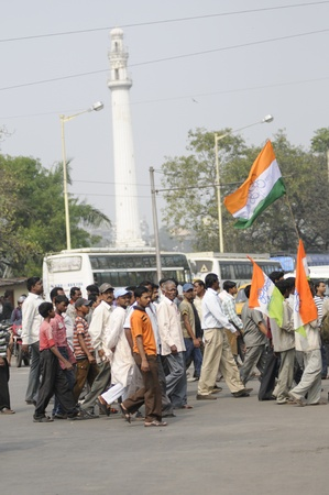 KOLKATA - FEBRUARY 20: Supporters of All India Trinamool Congress walking towards the rally that was organized to kick the 2011 election champagne, in Kolkata, India on February 20, 2011.