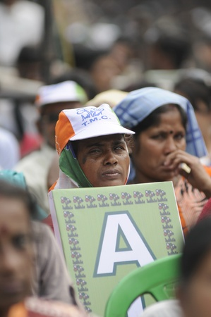 KOLKATA - FEBRUARY 20: A woman supporter of All India Trinamool Congress listening to the speaker during a rally organized to kick the 2011 election champagne, in Kolkata, India on February 20, 2011.