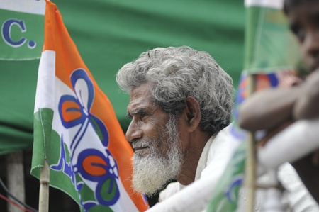 KOLKATA - FEBRUARY 20: An old man listening to the speeches during a rally organized by All India Trinamool Congress to kick the 2011 election champagne, in Kolkata, India on February 20, 2011.
