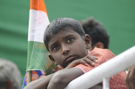 KOLKATA - FEBRUARY 20: A children listening to the speeches during a rally organized by All India Trinamool Congress to kick the 2011 election champagne, in Kolkata, India on February 20, 2011.