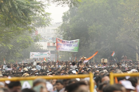 KOLKATA - FEBRUARY 20:Followers of All India Trinamool Congress appreciating speakers by waiving flags during a rally organized to kick the 2011 election campaign,in Kolkata,India on February 20, 2011.