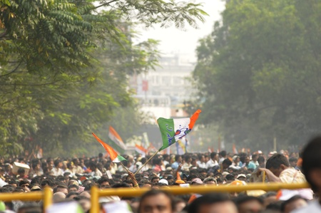 KOLKATA - FEBRUARY 20: Supporters of All India Trinamool Congress waiving their flags during a rally organized to kick the 2011 election campaign, in Kolkata, India on February 20, 2011.