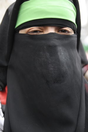 burqa: TORONTO - JANUARY 10: A Muslim woman during a rally to condemn the Israel occupation on Gaza on January 10 2009 in Toronto, Canada.
