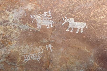 pintura rupestre: Una pintura rupestre prehistórico en Bhimbetka-India Foto de archivo