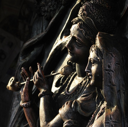 Hindu God Radha and Krishna carved on stone  Editorial
