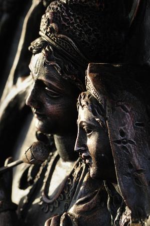 krishna: Hindu God Radha and Krishna carved on stone  Editorial