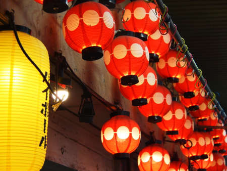 hustle: Red lanterns of a Japanese-style bar