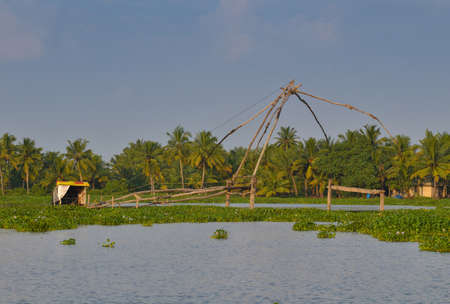 Alappuzha, Kerala, India - Circa November 2012 - Chinese fishing net in the backwaters of Alappuzha, Kerala, India