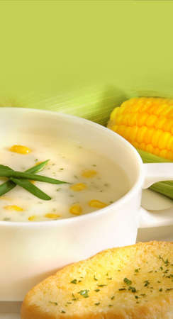 Fresh corn soup with bread Stock Photo