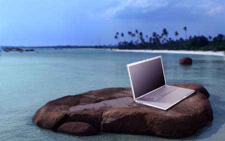 laptop on beach photo
