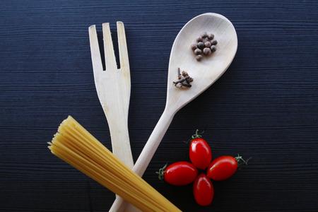 clove: spaghetti, spices clove,cherry tomatoes spoon