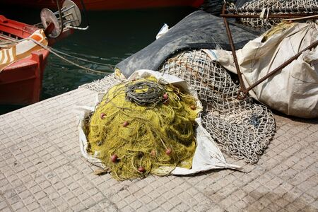 fishermans net: Fishermans net and  boat in harbour