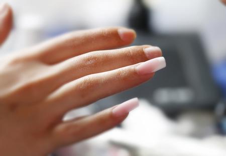 Nail manicure and polish in beauty salon in progress