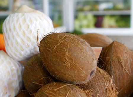 Fresh coconut in grocery shop