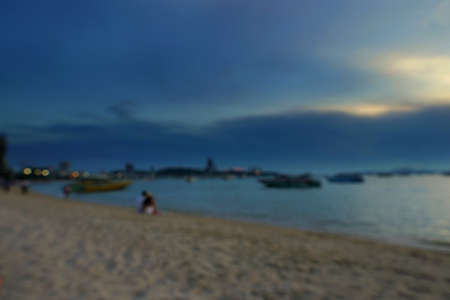 Blurred people having sunset beach in summer vacation as twilight times at Pattaya beach in Thailand. tourists take a photo with sea. View for seascape. Summer holiday and vacation concept for tourism Stock Photo