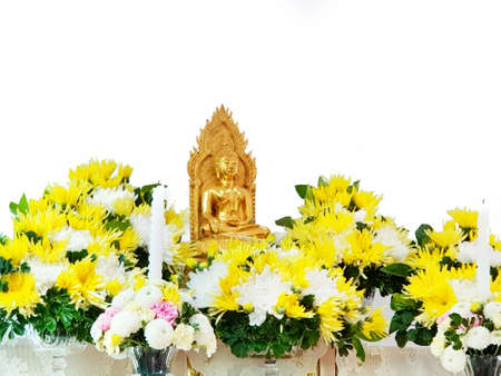Golden Buddha statue with chrysanthemum flowers  isolated on white background, Religion concept