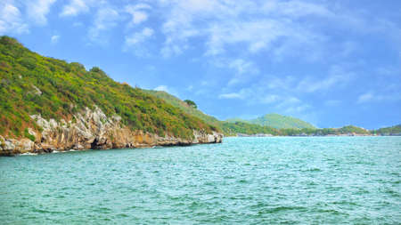 Beautiful tropical sea with mountain, blue sky and cloud at Koh Sichang in Thailand,  Space for text in template, Travel concept, Many tourists visit here, View for seascape