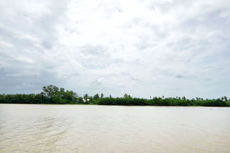 Bang Pakong River with sky, cloud and tree at Chachoengsao in Thailand, space for your text Imagens