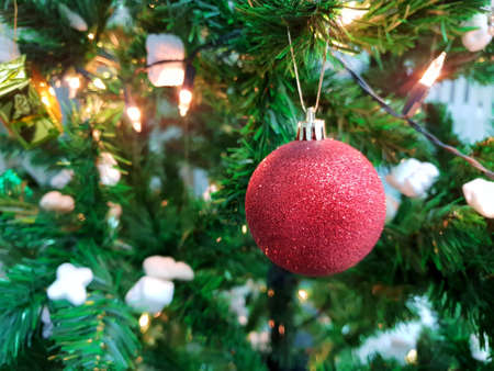 Decorated Christmas tree with red ball, Holiday background, Happy New Year and Xmas