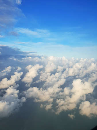Sky and cloud with the sun shining photo from airplane, cloudscape concept, Space for text in template, Vertical