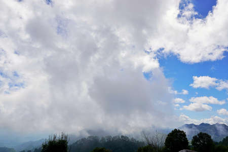 Beautiful landscape on mountain with sky and cloud, peace and relaxation, pictured from Space for text in template 免版税图像