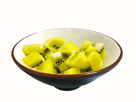 Top view of fresh sliced Kiwi fruit on white bowl isolated on white background, for making drinks or salads, healthy food concept