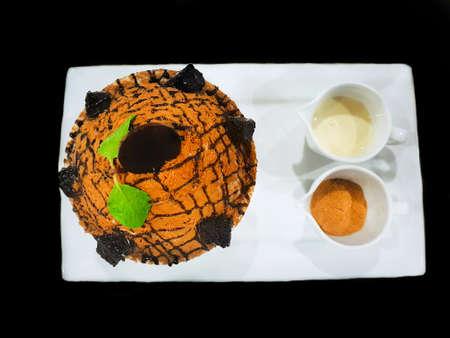 Bingsu dessert on white tray isolated on black background, Top view of choco volcano bingsu on white bowl, This dessert is most popular, Korean style Shaved ice dessert, Selective focus, bingsoo 免版税图像