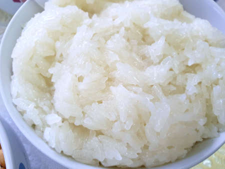 Top view of Sticky rice in white bowl for making Thai desserts