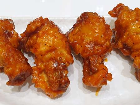 Korean food style, Top view of spicy chicken on white plate in restaurant, Yangnyeom Tongdak is Korea traditional Reklamní fotografie