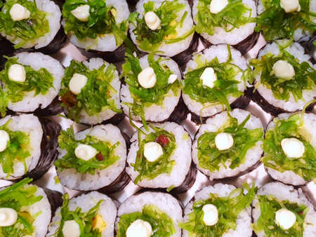 Japanese food style, Top view of sushi roll with wakame and  mayonnaise on top as a background, Ready to eat or serve