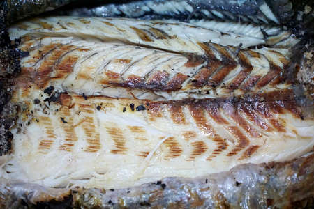 Top view of grilled fish fillet on foil as a background, Ready to eat or serve