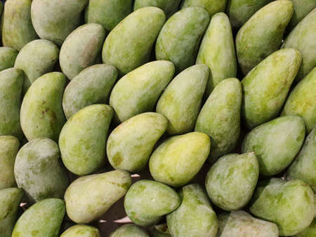 Top view of fresh green mango as a background in the supermarket at Thailand (Mangifera indica), Tropical fruit