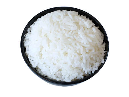 Top view of jasmine rice in a black bowl isolated on white background, copy space