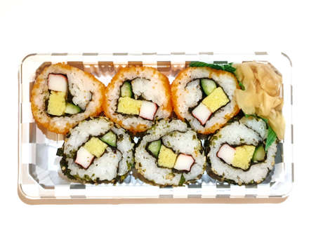 Japanese food style, Top view of california roll maki sushi with crab meat, mayonnaise, cucumber, avocado, caviar and sweet omelette isolated on white background, Ready to eat or serve, Set