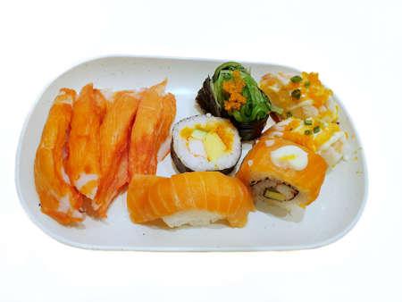 Japanese food style, Top view of variety sushi isolated on white background, Ready to eat or serve (Unagi,kani nigiri,ebi nigiri,salmon roll,Crab stick), set Banco de Imagens - 133148242