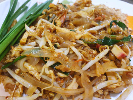 Thai food style, Top view of stir fried rice noodle as a background, Ready to eat or serve, This food is most popular, Pud Thai is Thai traditional, copy space Stock Photo - 133813656