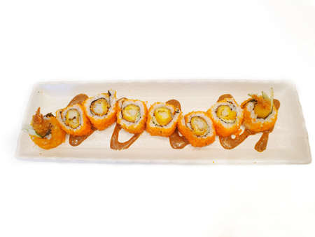 Japanese food style, Top view of california roll maki sushi with crispy fried dough topped with mayonnaise and teriyaki sauce isolated on white background, Ready to eat or serve (Kouen Crunchyroll)