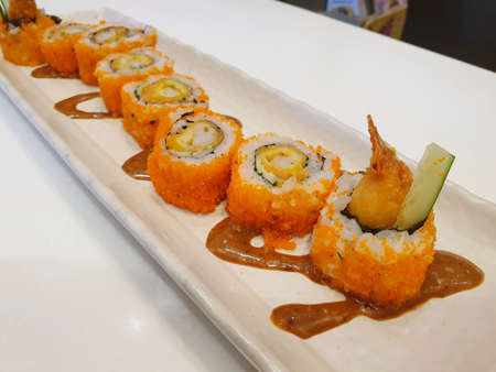 Japanese food style, Selective focus of california roll maki sushi with crispy fried dough topped with mayonnaise and teriyaki sauce in restaurant  (Kouen Crunchyroll) Reklamní fotografie