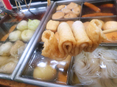 Japanese food style, Selective focus of various kinds of skewered oden in hot pot as a background, ready to eat, in street food