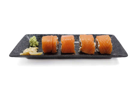 Japanese food style, Top view of salmon roll with wasabi and pickled ginger isolated on white background, Ready to eat or serve