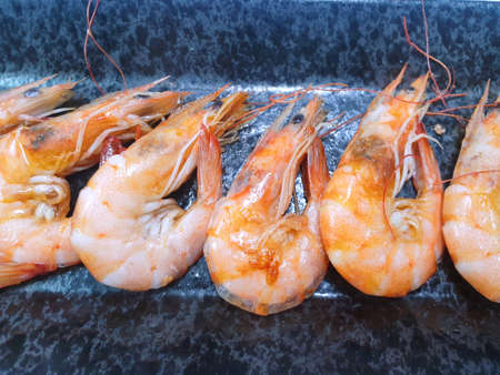 Top view of grilled prawns in black plate as a background, Ready to eat or serve